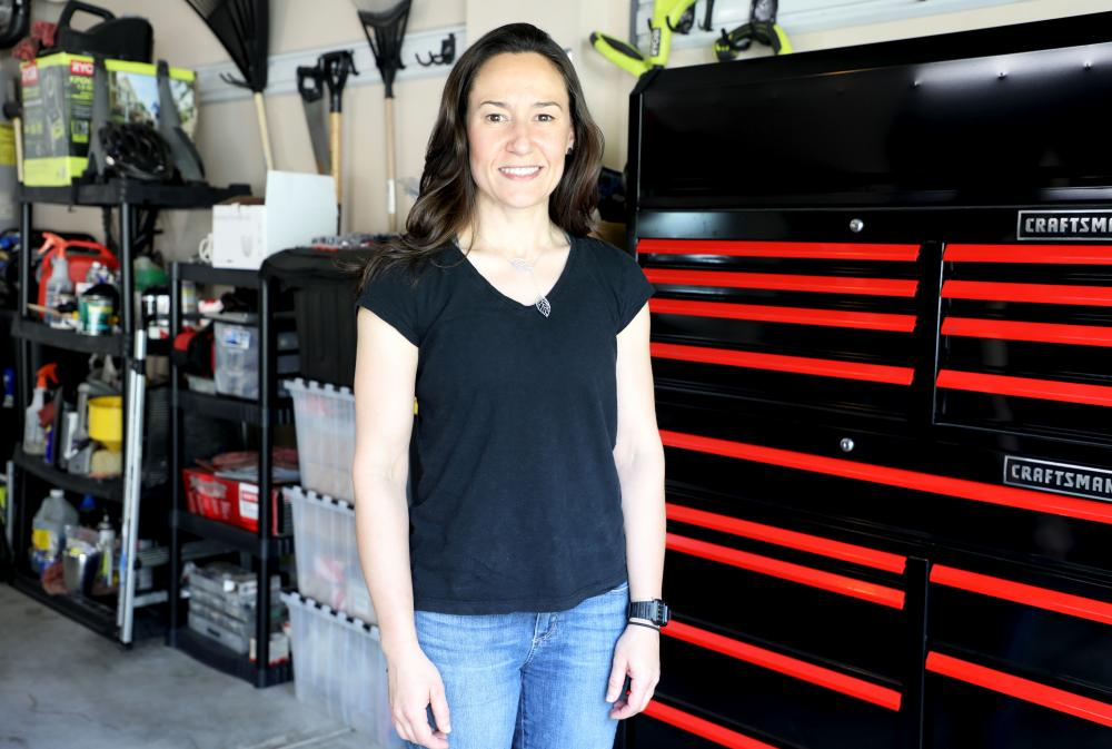 automotive graduate at her home shop