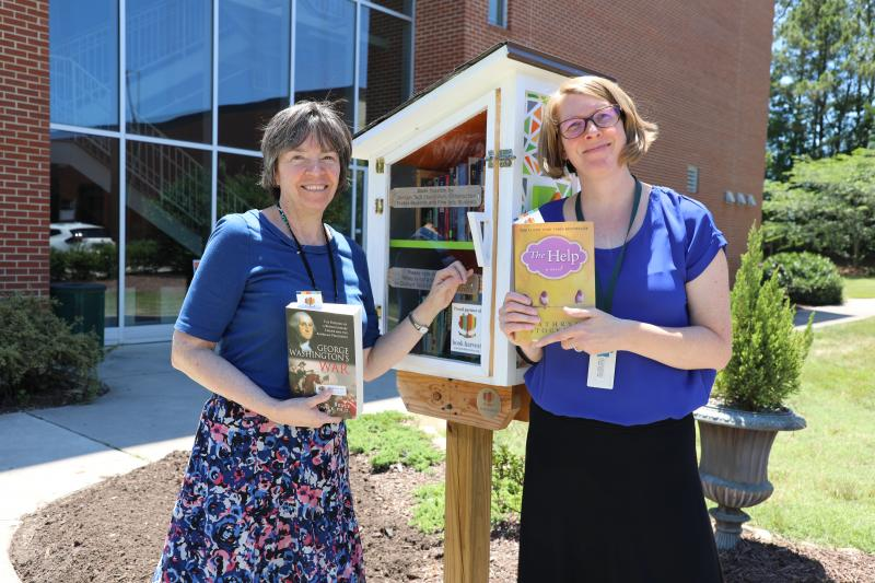 library staff at free little library on main campus