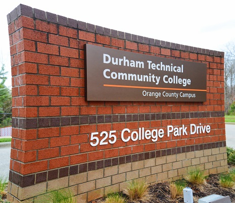 brick sign that says durham technical community college orange county campus and has address