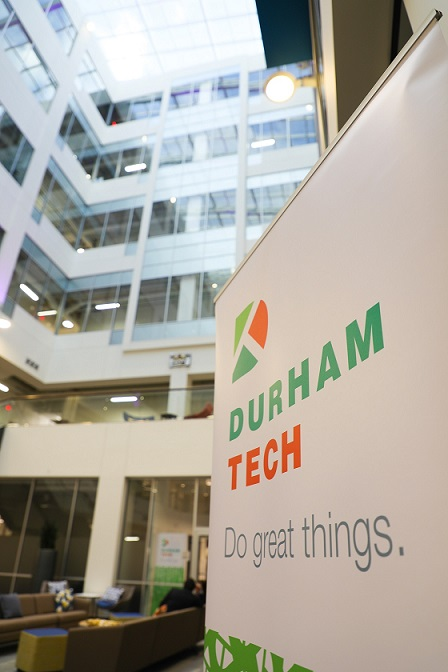 durham tech pop up banner in atrium of new building, looking upward