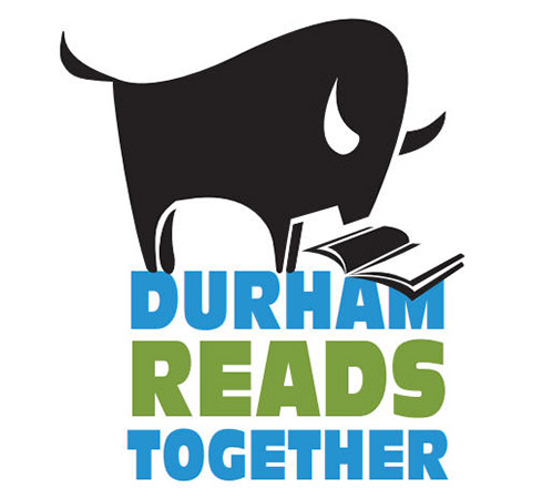 A bull reading a book with text Durham Reads Together
