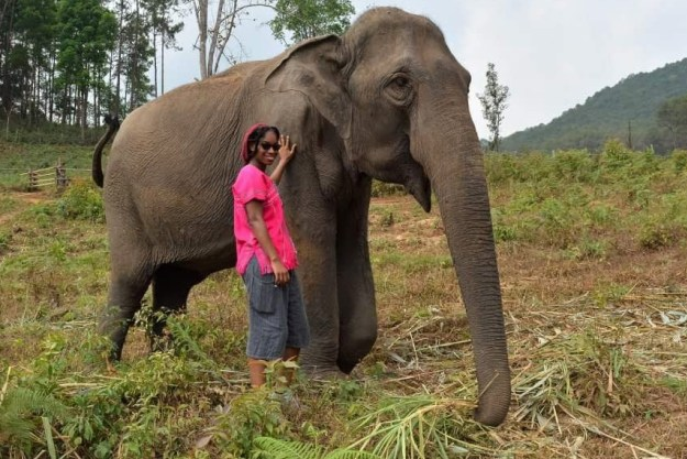 Jonitka poses next to an elephant