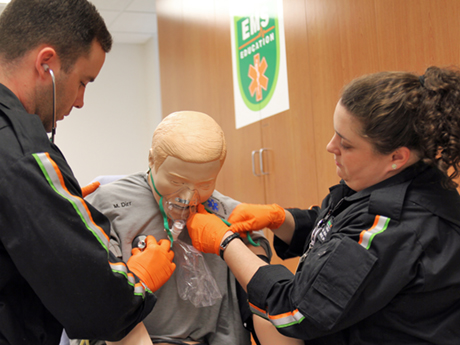 Two Emergency Medical Science students use a stethoscope on a training manikin during a class at the Durham Tech Orange County Campus.